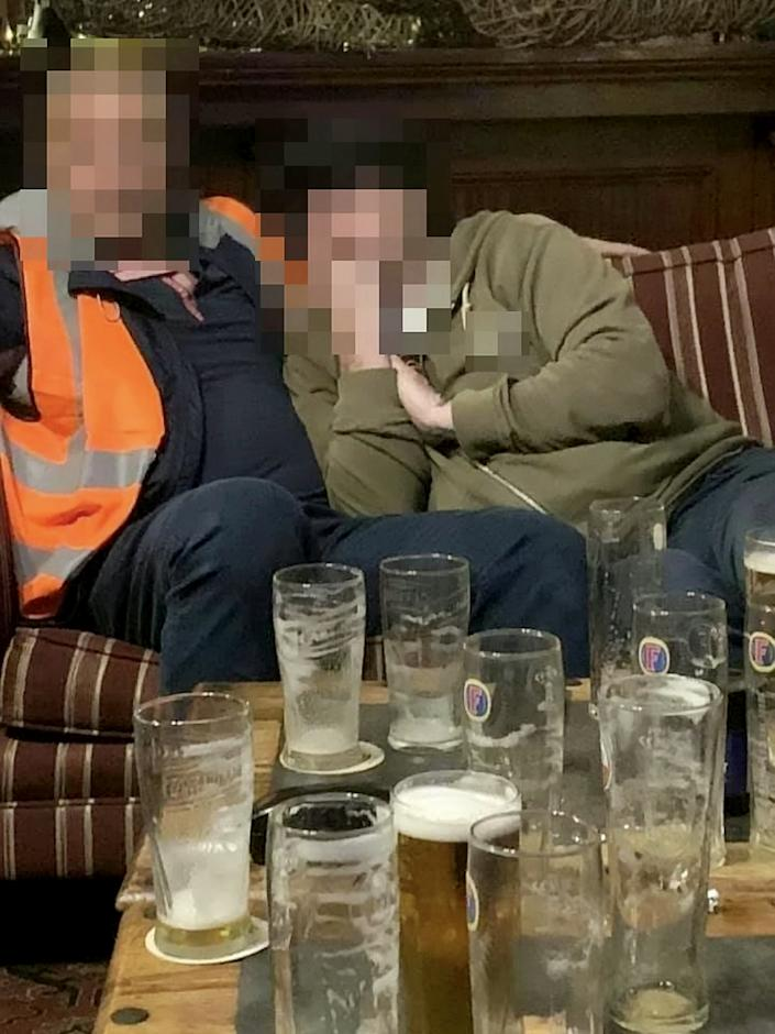 Up to 15 men packed into the bar (SWNS)