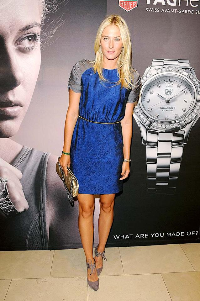 "Not only is Maria Sharapova back in action on the courts (following a 10-month absence), the tennis ace is also back on the red carpet. At a cocktail reception in Toronto, the three-time Grand Slam champ showed off her fantastic frame in a two-toned, belted sheath and Cole Haan heels. George Pimentel/<a href=""http://www.wireimage.com"" target=""new"">WireImage.com</a> - August 14, 2009"