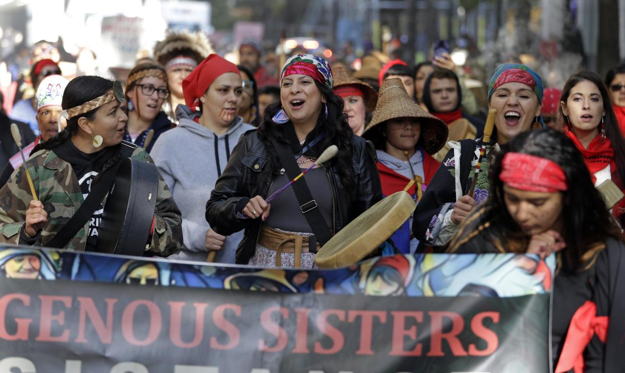 <p>Women drummers sing as they lead a march during an Indigenous Peoples Day event Monday, Oct. 9, 2017, in Seattle. In 2014, the Seattle City Council voted to stop recognizing Columbus Day and instead turned the second Monday in October into a day of recognition of Native American cultures and peoples. (Photo: Elaine Thompson/AP) </p>