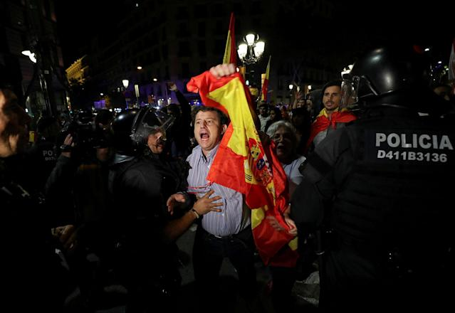 <p>A pro unity demonstrator is stopped by Catalan Regional Police officer during a protest after the Catalan regional parliament declared independence from Spain in Barcelona, Spain, Oct. 27, 2017. (Photo: Albert Gea/Reuters) </p>