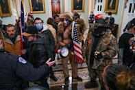 Supporters of US President Donald Trump, including men in bizarre costumes, invaded Congress