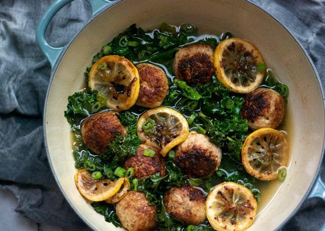 """No one can say no to kale when there are meatballs involved! <a href=""""https://www.bonappetit.com/recipe/gluten-free-chicken-meatballs-with-braised-lemon-and-kale?mbid=synd_yahoo_rss"""" rel=""""nofollow noopener"""" target=""""_blank"""" data-ylk=""""slk:See recipe."""" class=""""link rapid-noclick-resp"""">See recipe.</a>"""
