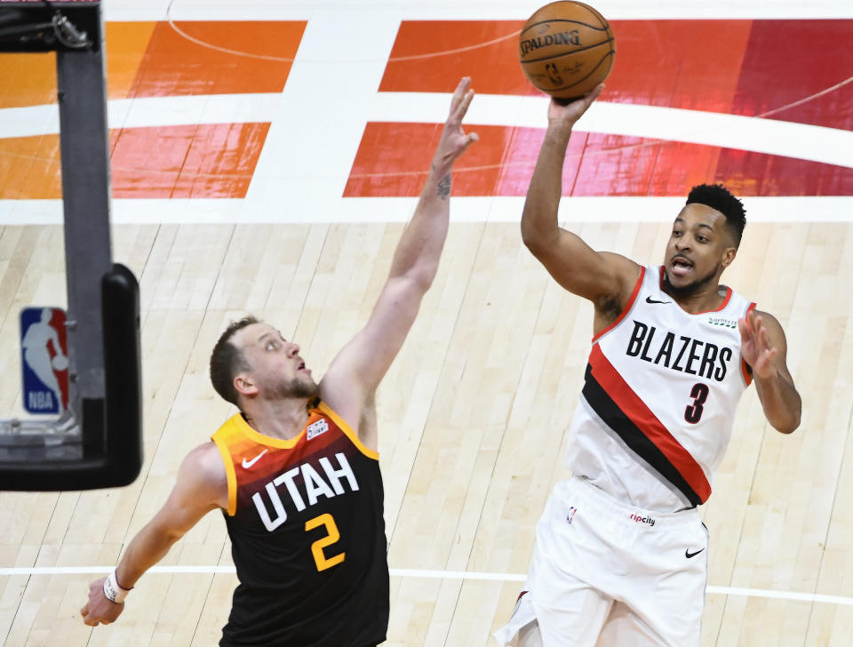 CJ McCollum #3 of the Portland Trail Blazers shoots over Joe Ingles #2 of the Utah Jazz during a game at Vivint Smart Home Arena on May 12, 2021 in Salt Lake City, Utah. NOTE TO USER: User expressly acknowledges and agrees that, by downloading and/or using this photograph, user is consenting to the terms and conditions of the Getty Images License Agreement. (Photo by Alex Goodlett/Getty Images)