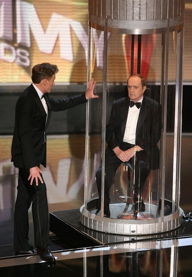 """Emmy hosts do make history from time to time, but they're hired to make us laugh.  And it's no easy feat to crack jokes in front of a room of insecure actors and the Hollywood power players who just may  be signing your next check.  Conan O'Brien rose to the challenge as host of the 2006 Emmy Awards.   And his memorable Bob Newhart gag deserves special recognition.  Awards shows are notorious for running long.  And most often, it's the result of long winded acceptance speeches (always thank your agent, director, family, God—in that order).  Conan O'Brien came up with an ingenious solution: lock Bob Newhart in a glass cage with exactly three hours of air.   """"If the Emmy's run one second over three hours, Bob Newhart dies…""""  Newhart's deadpan look of terror was worth the price of admission.  Conan O'Brien, host, and Bob Newhart during 58th Annual Primetime Emmy Awards - Show - Balcony at The Shrine Auditorium in Los Angeles, California, United States. (Photo by Jason Merritt/Getty Images)"""