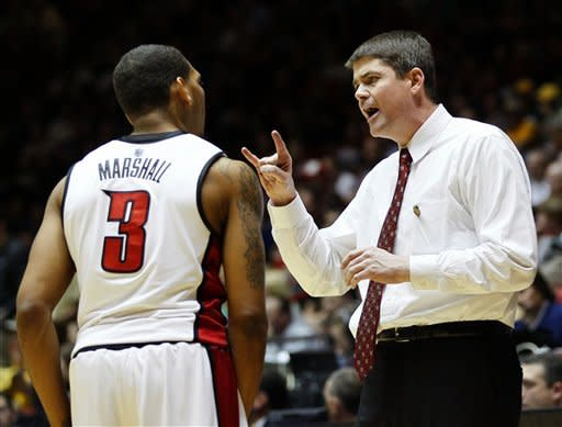 UNLV coach Dave Rice talks with Anthony Marshall (3) during the first half of an NCAA men's college basketball tournament second-round game against Colorado on Thursday, March 15, 2012, in Albuquerque, N.M. (AP Photo/Matt York)