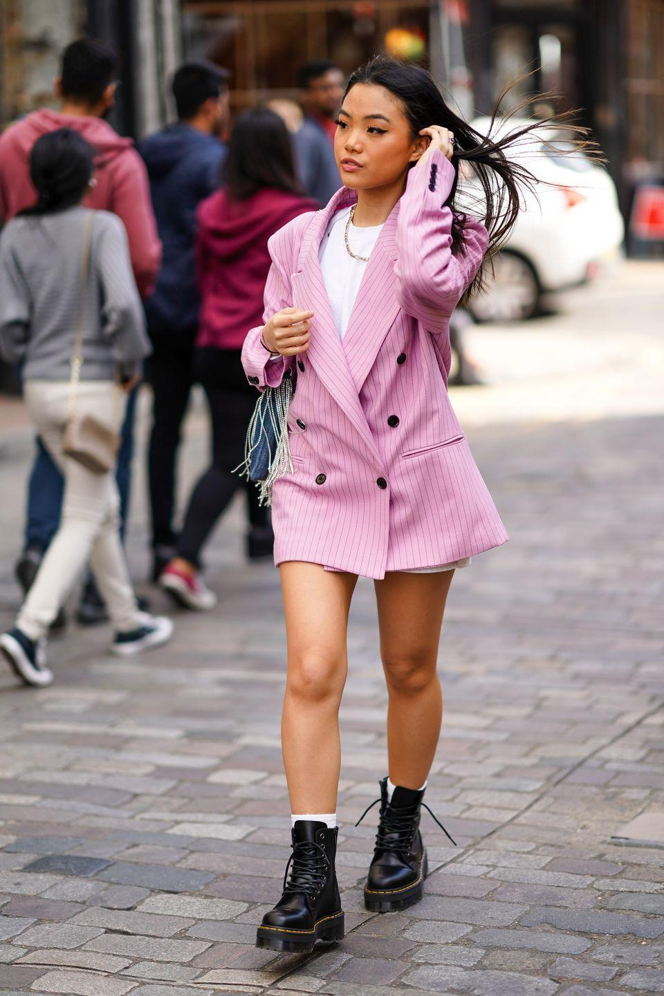 <p>An oversized blazer is a cute twist on a business room classic. Layer the jacket-turned-dress over a tee and short-shorts to stay covered while still showing major leg. Some delicate jewelry and a chunky boot are the best additions to this polished piece. <br><br></p>