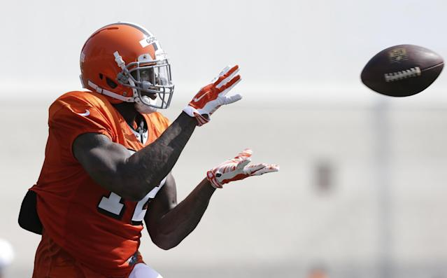 Cleveland Browns wide receiver Josh Gordon catches a pass during practice at the NFL football team's training camp Monday, Aug. 4, 2014, in Berea, Ohio. Gordon returned to practice while his appeal hearing with the NFL enters a second day in New York. Gordon missed two days of practice last week and Saturday's scrimmage in Akron. Gordon and his legal team met with an arbitrator for nearly 10 hours on Friday as he fights a potential one-year suspension for violating the league's substance abuse policy. (AP Photo/Tony Dejak)