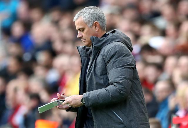 <p>Manchester United boss Jose Mourinho takes notes </p>