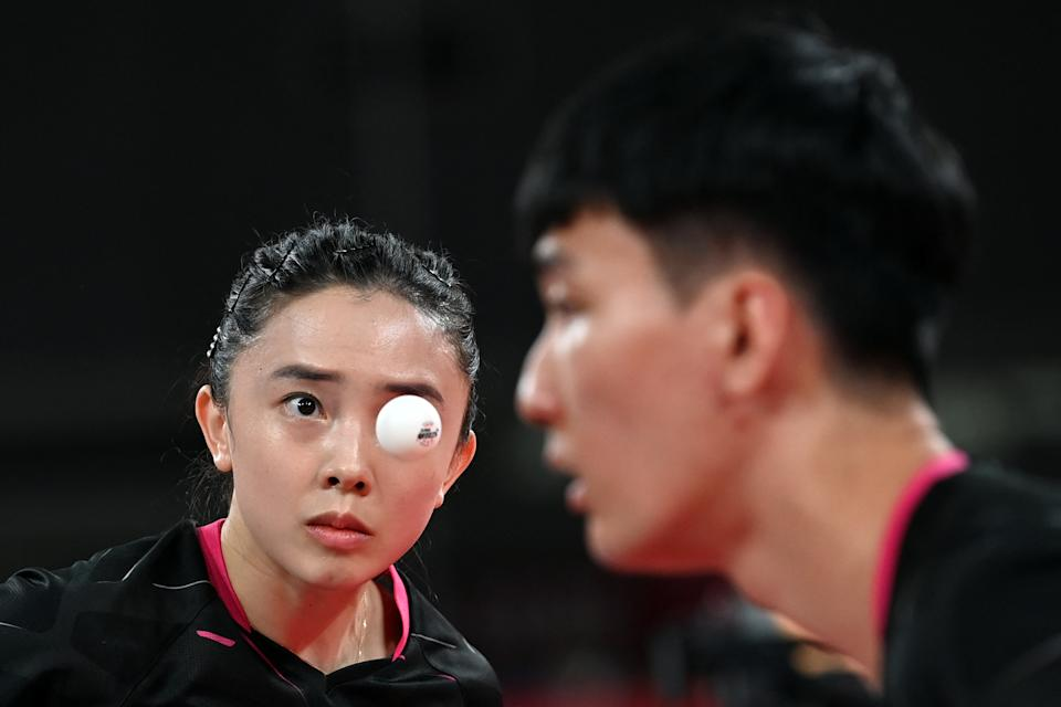 <p>Korea's Lee Sang-su (R) and Jeon Ji-hee compete against South Taiwan's Lin Yun-ju and Cheng I-ching during their mixed doubles quarterfinals table tennis match at the Tokyo Metropolitan Gymnasium during the Tokyo 2020 Olympic Games in Tokyo on July 25, 2021. (Photo by JUNG Yeon-je / AFP)</p>