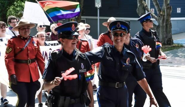 Members of the Royal Newfoundland Constabulary and RCMP have marched in Pride parades in St. John's, including this one in 2014. (Scott Jackson/CBC - image credit)
