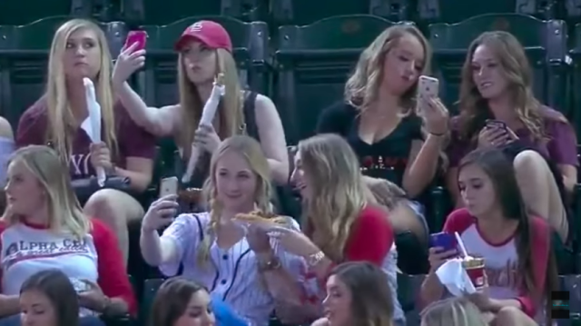 The girls were all fixated with getting the best shot. Source: Youtube / MLB Baseball