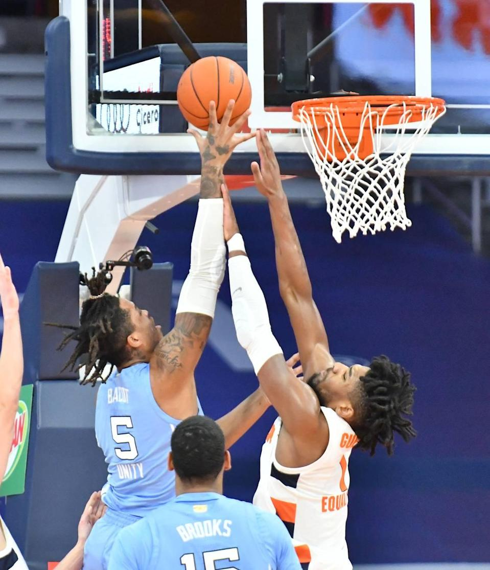 North Carolina Tar Heels forward Armando Bacot (5) shoots over Syracuse Orange forward Quincy Guerrier (1) in the first half at the Carrier Dome.