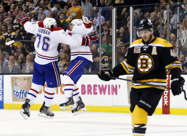 Montreal Canadiens defenseman Francis Bouillon jumps with defenseman P.K. Subban (76) to celebrate his goal as Boston Bruins center David Krejci, right, skates away during the third period in Game 1 of an NHL hockey second-round playoff series in Boston, Thursday, May 1, 2014. (AP Photo/Elise Amendola)