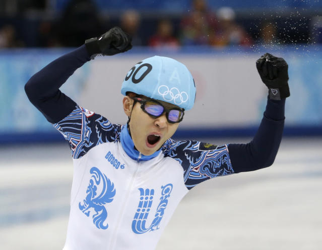 Victor An of Russia reacts after competing in a men's 5000m short track speedskating relay semifinal at the Iceberg Skating Palace during the 2014 Winter Olympics, Thursday, Feb. 13, 2014, in Sochi, Russia. (AP Photo/David Goldman)