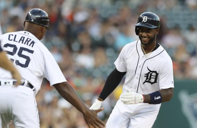 Detroit Tigers' Niko Goodrum is greeted by third base coach Dave Clark after hitting a two-run home run during the fourth inning of a baseball game against the Minnesota Twins, Friday, Aug. 10, 2018, in Detroit. (AP Photo/Carlos Osorio)