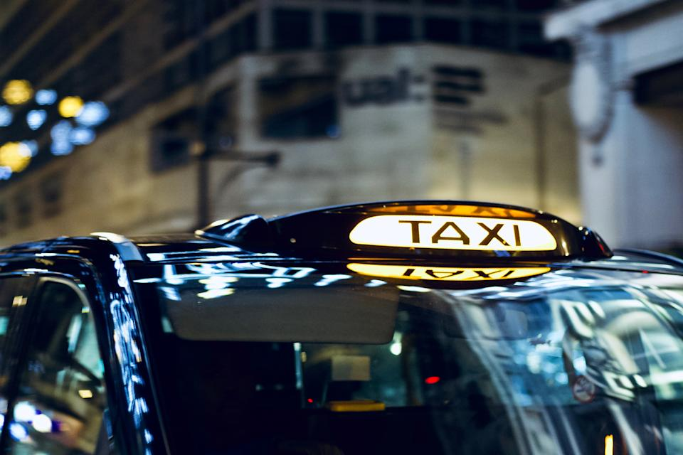 London /England - December 26 2017: Closeup to a London Taxi Sign on Oxford Street