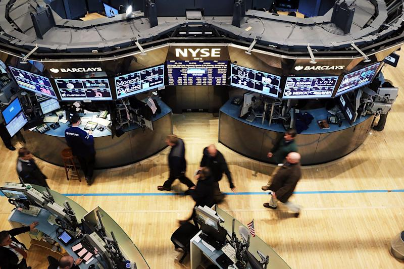 NEW YORK, NY - APRIL 02: Traders exit the floor of the New York Stock Exchange at the end of the trading day on April 2, 2013 in New York City. The Dow Jones Industrial average and the S&P 500 rose to new record highs on April 2, with the Dow finishing at a record close of 14,662. All three major indexes are up between about 10 percent and 12 precent for the year. (Photo by Spencer Platt/Getty Images)