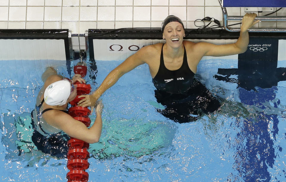 United States' Dana Vollmer, right, reacts after winning gold and setting a world record in the women's 100-meter butterfly swimming final at the Aquatics Centre in the Olympic Park during the 2012 Summer Olympics in London, Sunday, July 29, 2012. Vollmer set a new world record with a time of 55.98. (AP Photo/Mark Duncan)