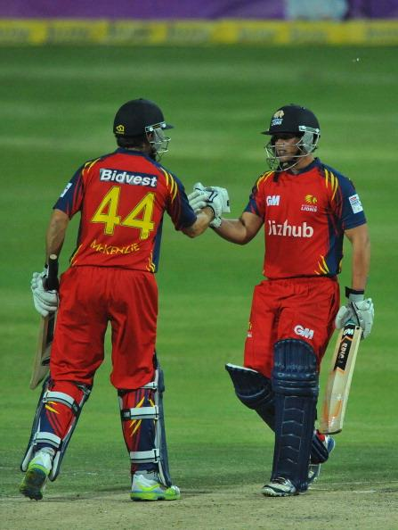 JOHANNESBURG, SOUTH AFRICA - OCTOBER 14:  Quinton de Kock of the Lions celebrates reaching his 50 with Neil McKenzie (L) during the Karbonn Smart CLT20 match between Highveld Lions and Mumbai Indians at Bidvest Wanderers Stadium on October 14, 2012 in Johannesburg, South Africa.  (Photo by Duif du Toit/Gallo Images/Getty Images)