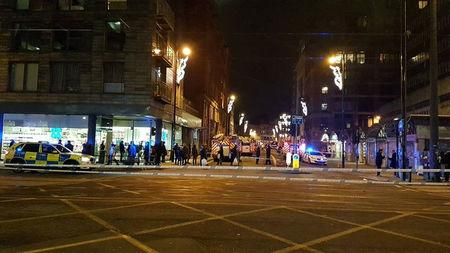 Police close the road after fire breaks out at an apartment block in Manchester, Britain December 30, 2017 in this image obtained from social media. TWITTER/@MANCTRAFFIC/via REUTERS.