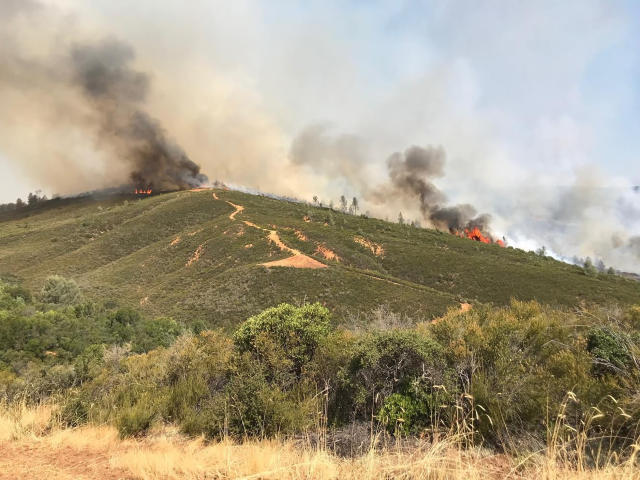 <p>In this photo provided by the California Department of Forestry and Fire Protection, the Pawnee Fire wildfire burns northeast of Clearlake Oaks, Calif., early Sunday, June 24, 2018. The Pawnee Fire, which broke out Saturday, was one of four wildfires burning in largely rural areas as wind and heat gripped a swath of California from San Jose to the Oregon border. (Photo: Jonathan Cox/California Department of Forestry and Fire Protection via AP) </p>