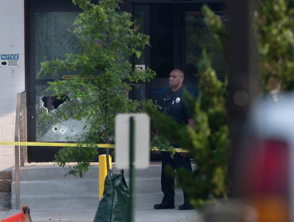 Metro Police investigate a shooting after an employee opened fire and shot three other employees at the Smile Direct Club warehouse Tuesday, Aug. 3, 2021 in Nashville, Tenn.