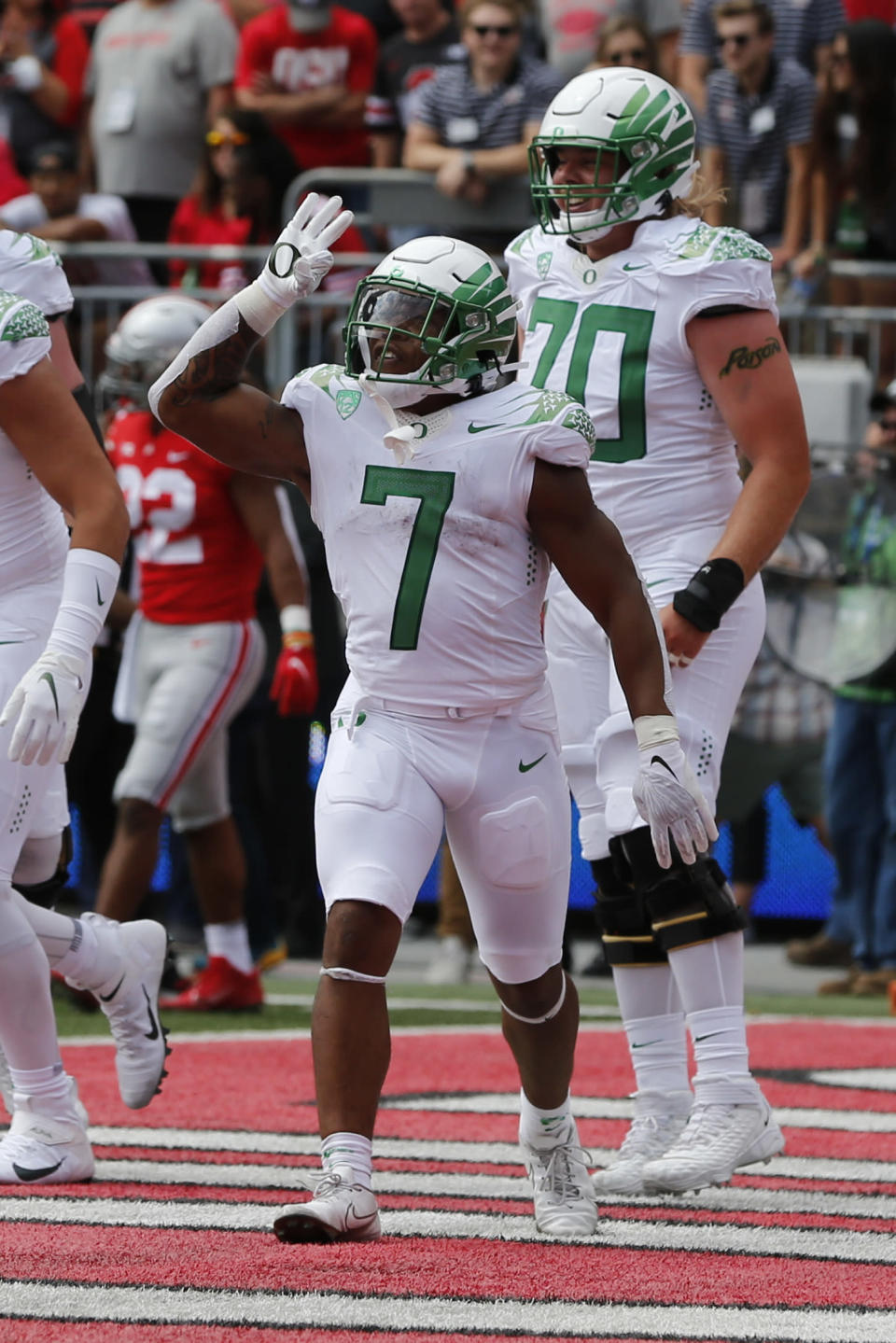Oregon running back CJ Verdell celebrates his touchdown against Ohio State during the first half of an NCAA college football game Saturday, Sept. 11, 2021, in Columbus, Ohio. (AP Photo/Jay LaPrete)