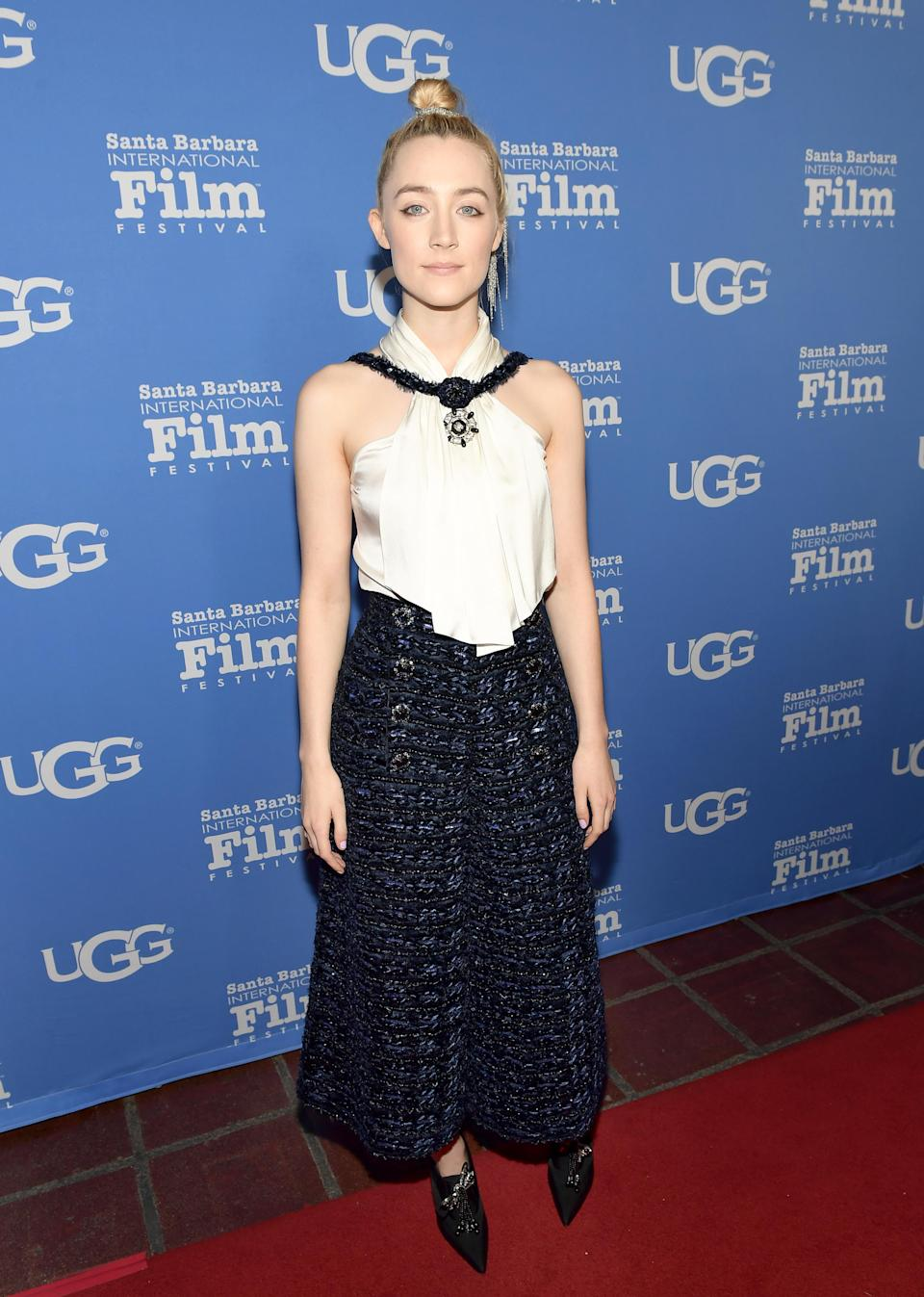 <p>The actress made a style statement in a Chanel outfit teamed with a top knot. <em>[Photo: Getty]</em> </p>