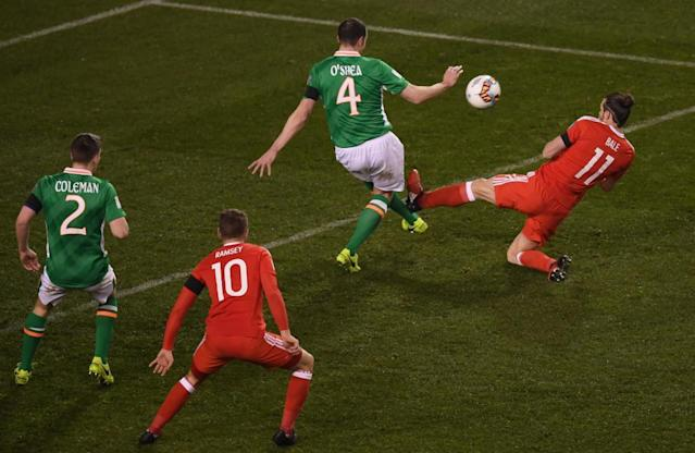 "<span class=""element-image__caption"">Gareth Bale flies in on John O'Shea.</span> <span class=""element-image__credit"">Photograph: Stephen McCarthy/Sportsfile via Getty Images</span>"