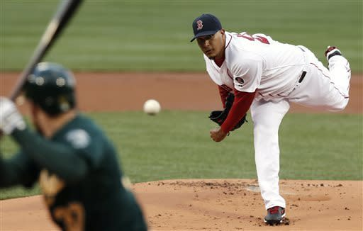 Boston Red Sox starting pitcher Felix Doubront delivers against the Oakland Athletics during the first inning of a baseball game at Fenway Park in Boston on Monday, April 22, 2013. (AP Photo/Winslow Townson)