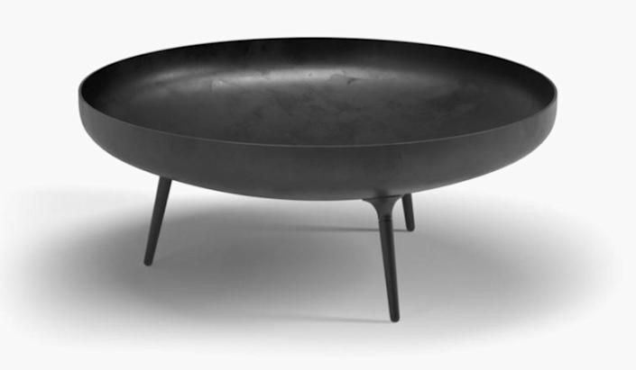 """This modern outdoor fire pit by Henrik Pedersen is all clean lines and charm. Made of powder-coated steel, you can burn any type of wood in it and it looks just as beautiful as a design object. $1740, Design Within Reach. <a href=""""https://www.dwr.com/outdoor-fire-pits/deco-fire-bowl/100193980.html?lang=en_US"""" rel=""""nofollow noopener"""" target=""""_blank"""" data-ylk=""""slk:Get it now!"""" class=""""link rapid-noclick-resp"""">Get it now!</a>"""