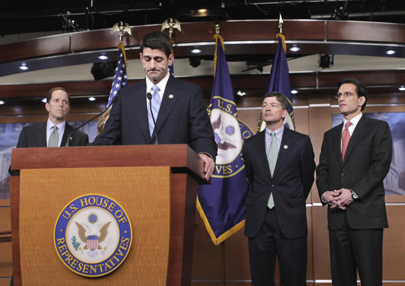 "House Budget Committee Chairman Rep. Paul Ryan, R-Wis., at podium, declares that he was ""disappointed"" in President Obama's speech on a federal spending plan, Wednesday, April 13, 2011, during a news conference on Capitol Hill in Washington. From left are: House Ways and Means Committee Chairman Rep. Dave Camp, R-Mich., Ryan, Republican Conference Chairman Rep. Jeb Hensarling, R-Texas, and House Majority Leader Eric Cantor of Va.   (AP Photo/J. Scott Applewhite)"