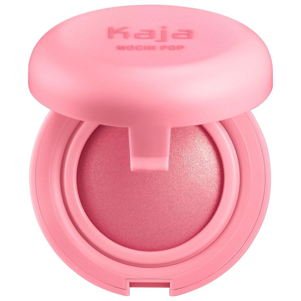 <p>Press your fingers lightly into the <span>Kaja Mochi Pop Bouncy Blush</span> ($19) before spreading on the cheeks for a pop of color. </p>
