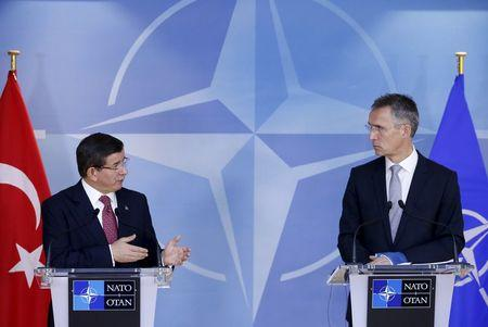 Turkish Prime Minister Davutoglu and NATO Secretary-General Stoltenberg address a joint news conference at the Alliance's headquarters in Brussels