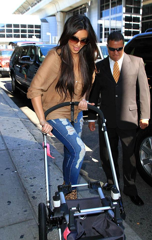 "Kourtney's sis Kim -- who helped to fold up Mason's baby stroller -- was super excited to spend the holiday in NYC with her nephew. ""Welcome to New York!!!!"" she tweeted. ""It feels so good to be here! Such a beautiful day here! Boat time!"" Jackson Lee/<a href=""http://www.splashnewsonline.com/"" target=""new"">Splash News</a> - September 6, 2010"