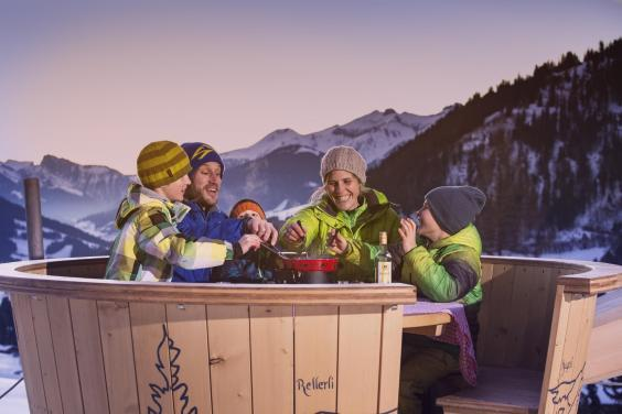 Eating molten cheese in the dairy's giant fondue pot (Gstaad tourist board)