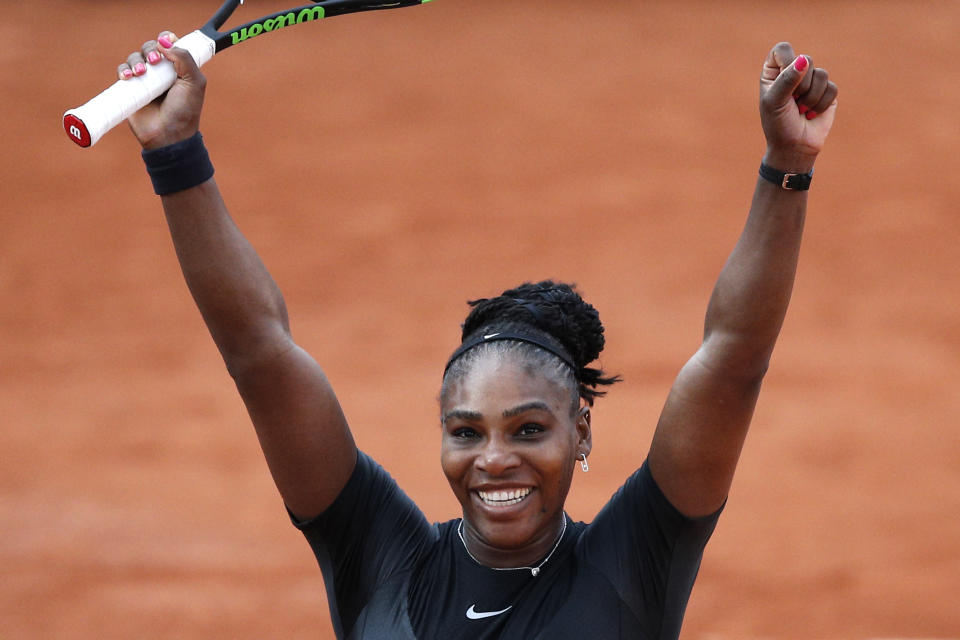 Serena Williams celebrates after defeating Germany's Julia Georges during their third round match of the French Open tennis tournament at the Roland Garros. (AP Photo)