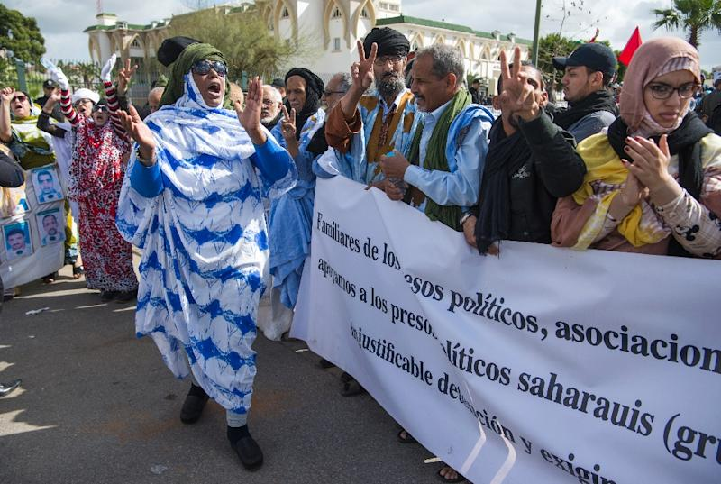 Supporters of the Western Sahara's Polisario Front shout slogans during a demonstration outside the court in Sale on March 13, 2017