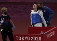 United States's Anastasija Zolotic celebrates with coach after defeating Taiwan's Lo Chia-Ling during the taekwondo women's 57kg match at the 2020 Summer Olympics, Sunday, July 25, 2021, in Tokyo, Japan. (AP Photo/Themba Hadebe)