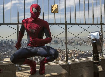 """A stunt man dressed as Spider-Man, poses during a photo call for the film """"The Amazing Spider-Man 2"""", at the Empire State Building in New York"""
