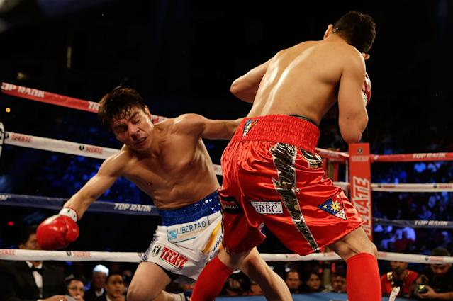 HOUSTON, TX - DECEMBER 15: Nonito Donaire of the Philippines (R) hits Jorge Arce of Mexico during their WBO World Super Bantamweight bout at the Toyota Center on December 15, 2012 in Houston, Texas. (Photo by Scott Halleran/Getty Images)