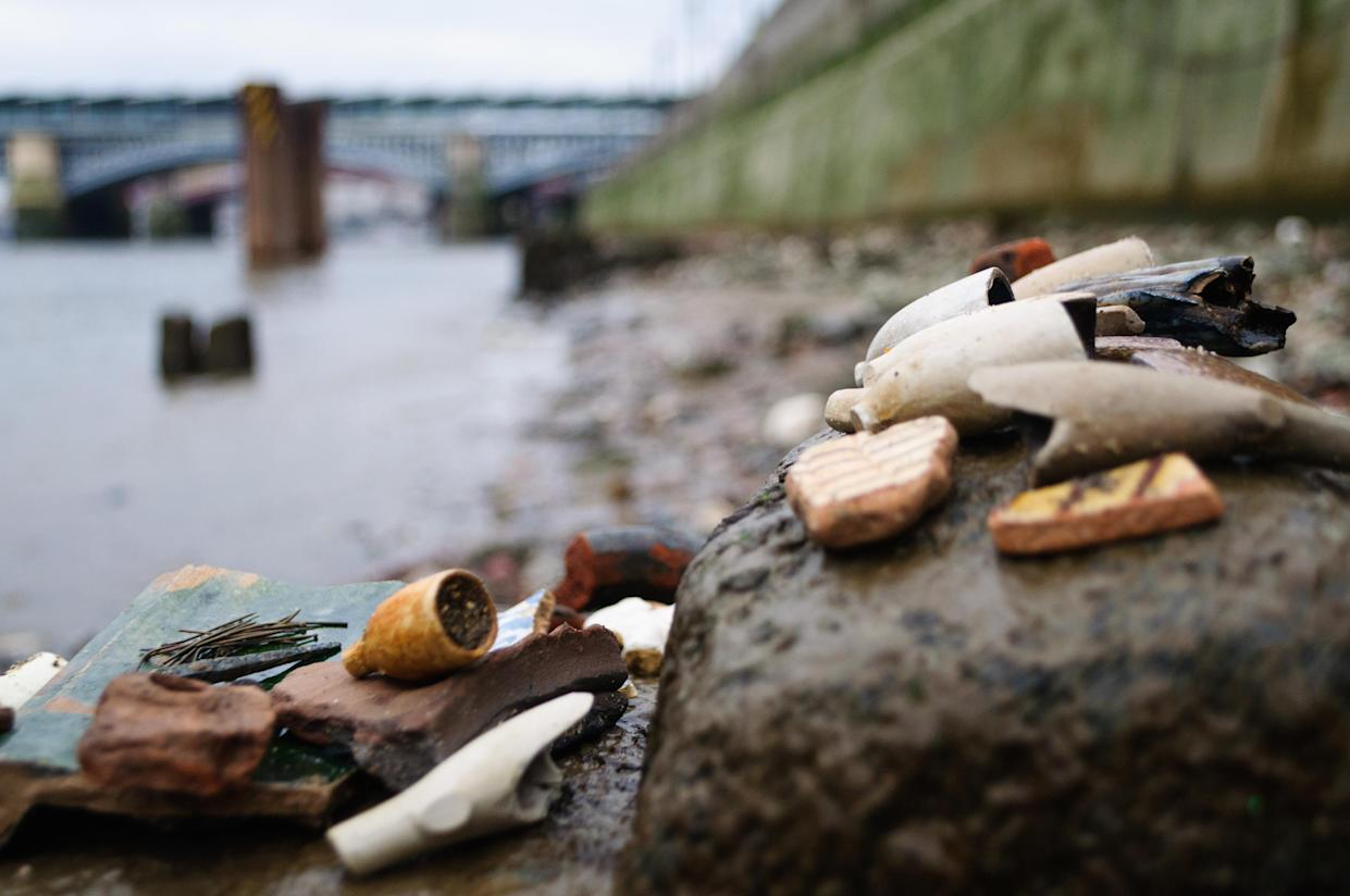 Close up of objects found while mudlarking on the River Thames