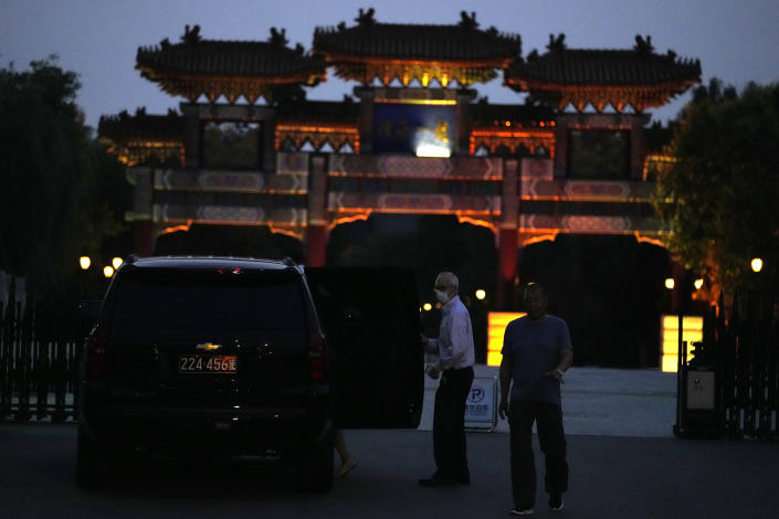 A man exits a U.S. embassy car outside the Tianjin Binhai No. 1 Hotel where U.S. and Chinese officials are expected to hold talks in Tianjin municipality in China on Sunday, July 25, 2021. Deputy Secretary of State Wendy Sherman travelled to China this weekend on a visit that comes as tensions between Washington and Beijing soar on multiple fronts, the State Department said Wednesday. (AP Photo/Ng Han Guan)