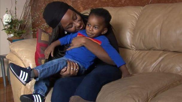 PHOTO: Jasmin Ford, 30, holds her son, Caleb, after receiving a surprise student loan payment from Fifth Third Bank. (WLS)