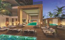 "<p>Located on an exclusive stretch of The Palm Beaches lies the next great wellness retreat: <a href=""https://www.amritocean.com/"" rel=""nofollow noopener"" target=""_blank"" data-ylk=""slk:Amrit Ocean Resort & Residences"" class=""link rapid-noclick-resp"">Amrit Ocean Resort & Residences</a>. This property is centered on five pillars: mindfulness, nutrition, fitness, relaxation and sleep—all of which will aid you on your own personal wellness journey. Besides an individually curated wellness experience and fabulous spa, the <a href=""https://www.preferredhotels.com/"" rel=""nofollow noopener"" target=""_blank"" data-ylk=""slk:Preferred Hotels & Resorts"" class=""link rapid-noclick-resp"">Preferred Hotels & Resorts </a>property will offer five spectacular dining options, cooking classes, an array of outdoor sports, and a sleek rooftop pool for an unforgettable vacation. The good news: residences are available if you never want to leave.</p><p><em>Amrit Ocean Resort & Residences is expected to open on April 1, 2021 with rates starting at $525 per night.</em> </p>"