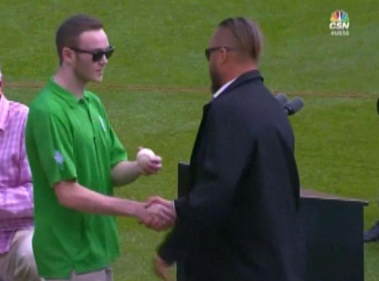 Tommy Maloney presented Mark Buehrle with the baseball from his famous between-the-legs defensive play. (Comcast SportsNet Chicago)