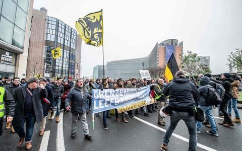 People wave the flag of the Flanders as they take part in a protest organised by Right-wing Flemish party Vlaams Belang - Credit: JONAS ROOSENS / BELGA / AFP