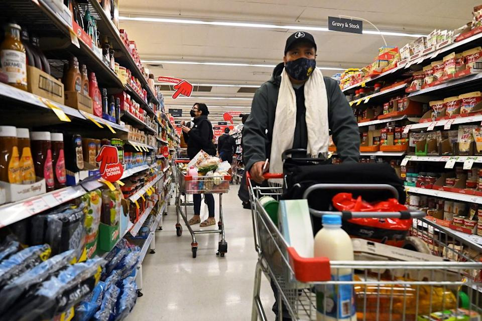 Residents stock up on provisions at a shopping centre in Sydney.