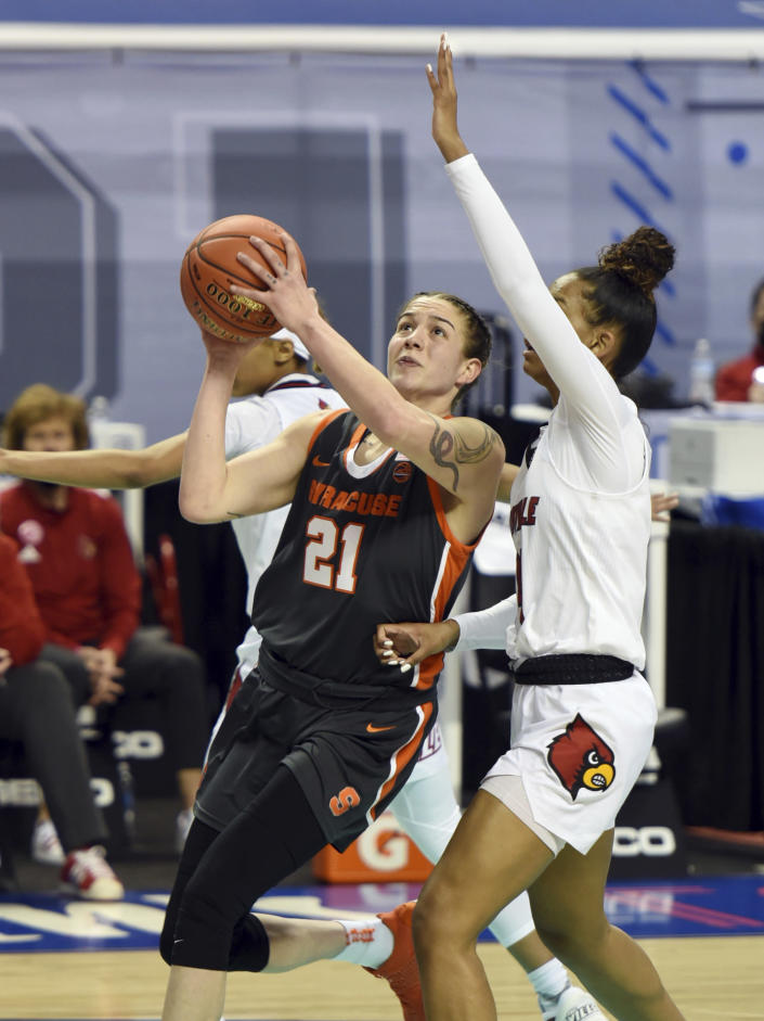 Syracuse's Emily Engstler drives to the basket under pressure from Louisville's Kianna Smith during an NCAA college basketball game in the semifinals of Atlantic Coast Conference tournament in Greensboro, N.C., Saturday, March 6, 2021. (Walt Unks/The Winston-Salem Journal via AP)