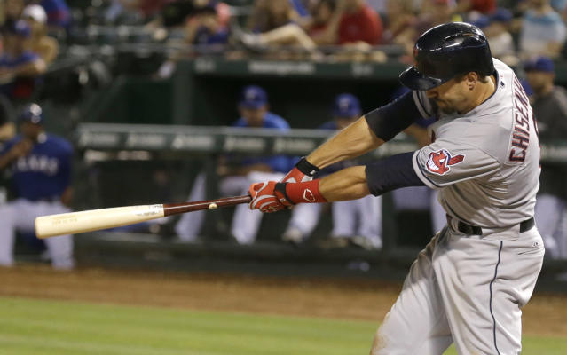 Cleveland Indians Lonnie Chisenhall follows through on a swing hitting a three run homer during the eighth inning of a baseball game against the Texas Rangers in Arlington, Texas, Monday, June 9, 2014. (AP Photo/LM Otero)